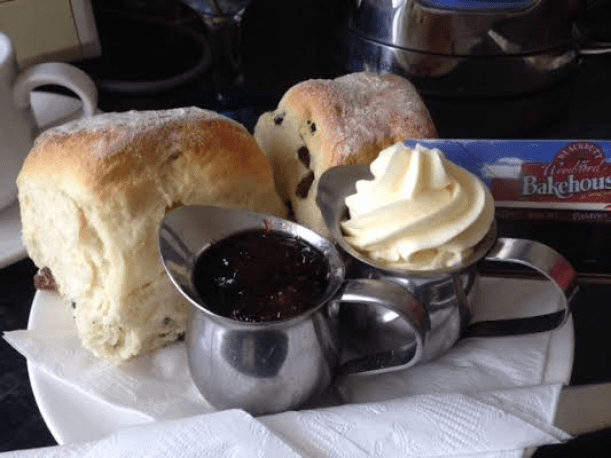 Soft moist butter milk scones with fresh cream and handmade raspberry sauce